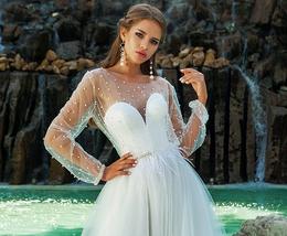 Скидка 15% на свадебные платья + подарок